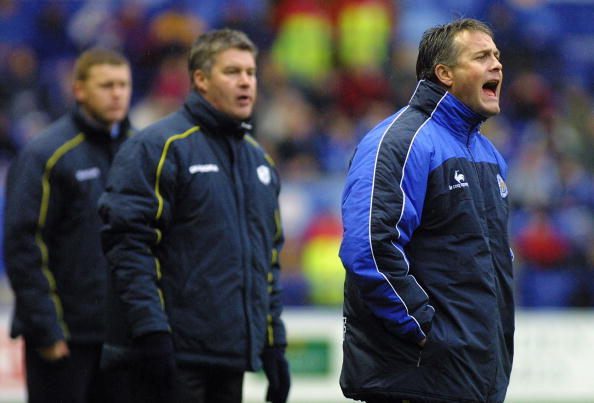 Leicester City manager Micky Adams shouts at his players while Sheffield Wednesday manager Chris Turner looks on
